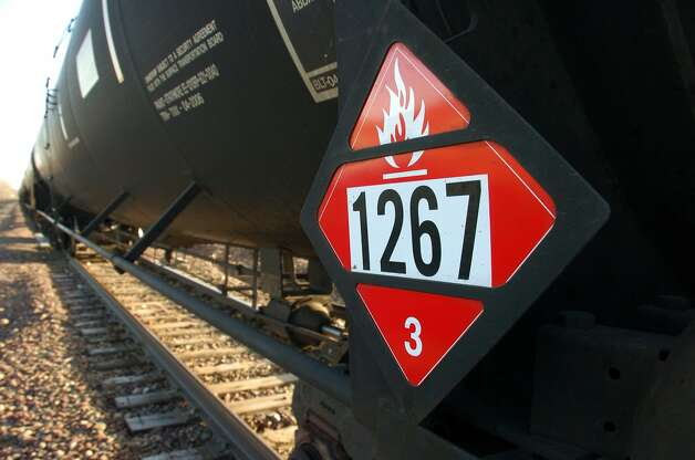 A placard on a tank car in North Dakota, below, warns that it's carrying flammable crude oil. Trains like these are being used more frequently to deliver petroleum to California. Photo: Matthew Brown, Associated Press