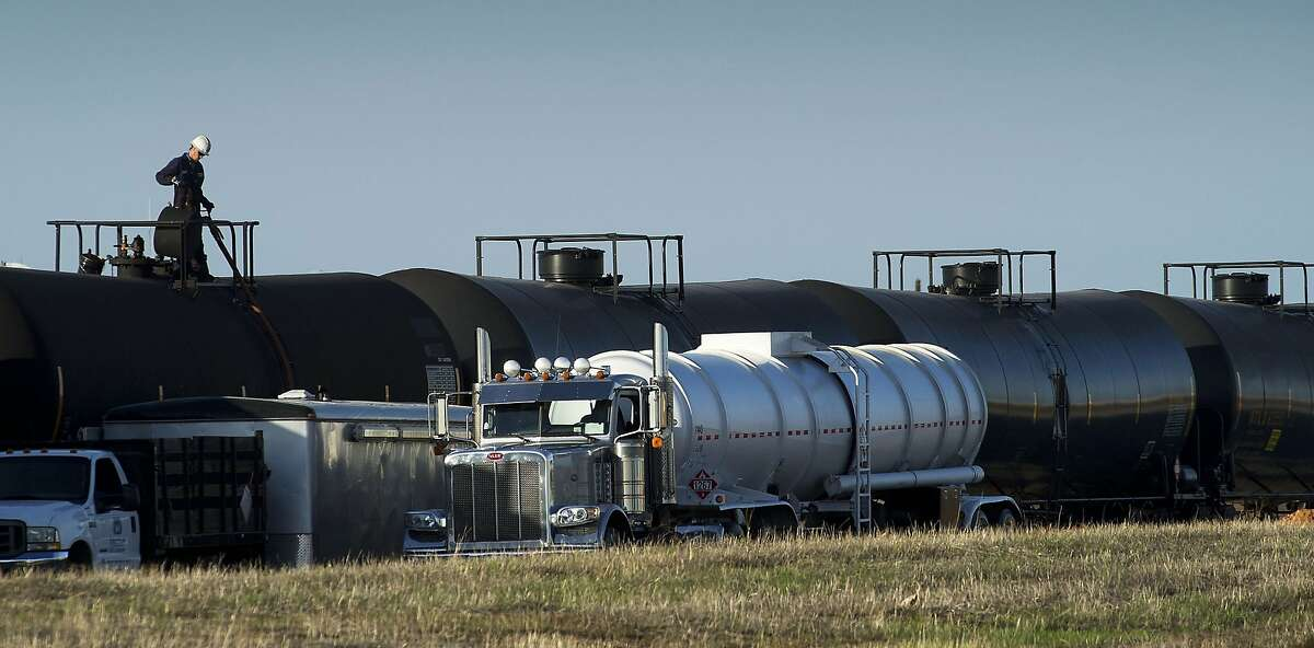 A tanker truck is filled from railway cars containing crude oil on railroad tracks in McClellan Park in North Highlands on Wednesday, March 19, 2014. North Highlands is a suburb just outside the city limits of Sacramento, CA. (Randall Benton/Sacramento Bee/MCT)