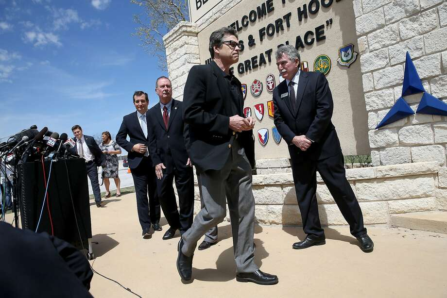 Texas Sen. Ted Cruz (far left) and Gov. Rick Perry (center) visit the wounded and meet with the press at Fort Hood. Photo: Joe Raedle, Getty Images