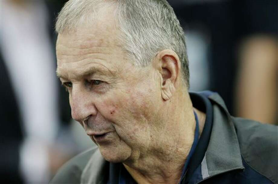Former Connecticut head coach  Jim Calhoun is interviewed by members of the media during the team's  practice for their NCAA Final Four tournament college basketball  semifinal game Friday, April 4, 2014, in Dallas. Connecticut plays  Florida on Saturday, April 5, 2014. (AP Photo/Charlie Neibergall)