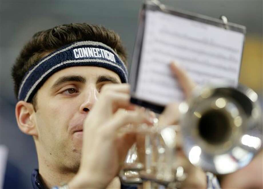 A member of the Connecticut  band plays during practice for the team's their NCAA Final Four  tournament college basketball semifinal game Friday, April 4, 2014, in  Dallas. Connecticut plays Florida on Saturday, April 5, 2014. (AP  Photo/Eric Gay)