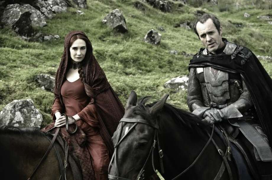 Carice van Houtenas Melisandre the Red Priestess, alongside Stephen Dillane as Stannis Baratheon.