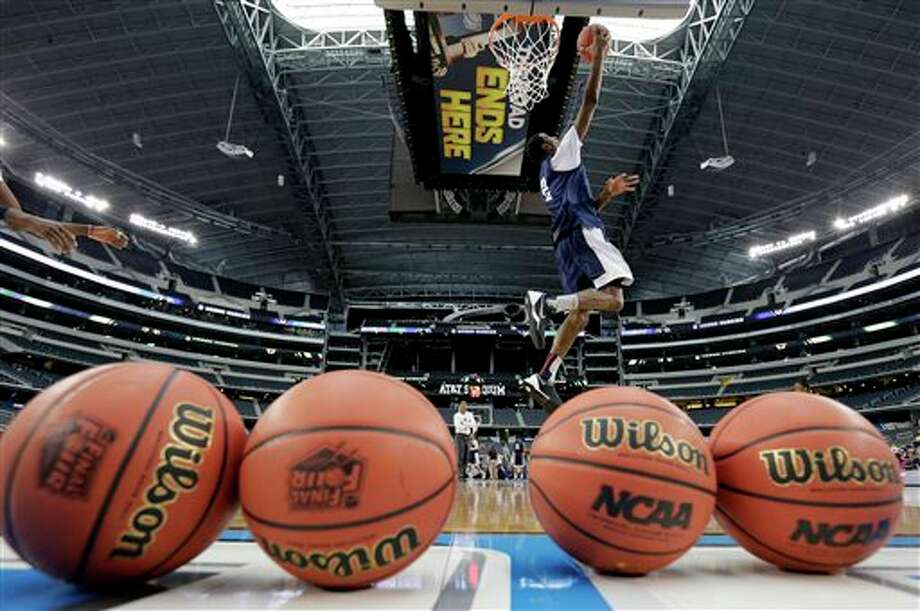 Connecticut forward DeAndre  Daniels shoots the ball during team practice for their NCAA Final Four  tournament college basketball semifinal game Friday, April 4, 2014, in  Dallas. Connecticut plays Florida on Saturday, April 5, 2014. (AP  Photo/Eric Gay)