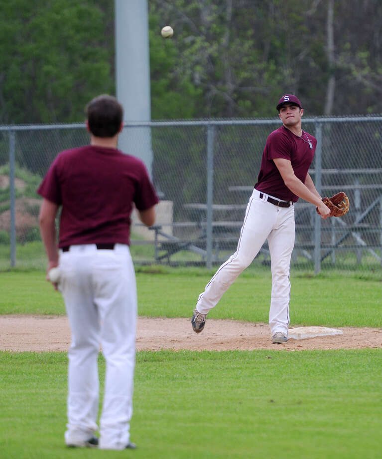 Kris Ellers throws toward the pitcher's mound from first base during practice Thursday. The Silsbee High School baseball team practiced Thursday afternoon. Photo taken Thursday, 4/3/14 Jake Daniels/@JakeD_in_SETX Photo: Jake Daniels / ©2014 The Beaumont Enterprise/Jake Daniels