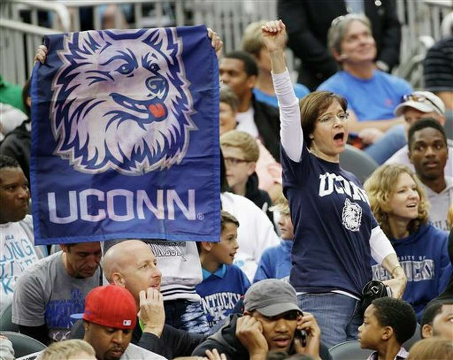 Connecticut fans cheer during  the team's practice for their NCAA Final Four tournament college  basketball semifinal game Friday, April 4, 2014, in Dallas. Connecticut  plays Florida on Saturday, April 5, 2014. (AP Photo/David J. Phillip)