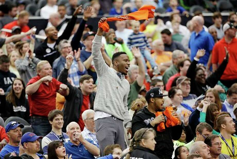 Fans cheer during  Connecticut's practice for their NCAA Final Four tournament college  basketball semifinal game Friday, April 4, 2014, in Dallas. Connecticut  plays Florida on Saturday, April 5, 2014. (AP Photo/David J. Phillip)
