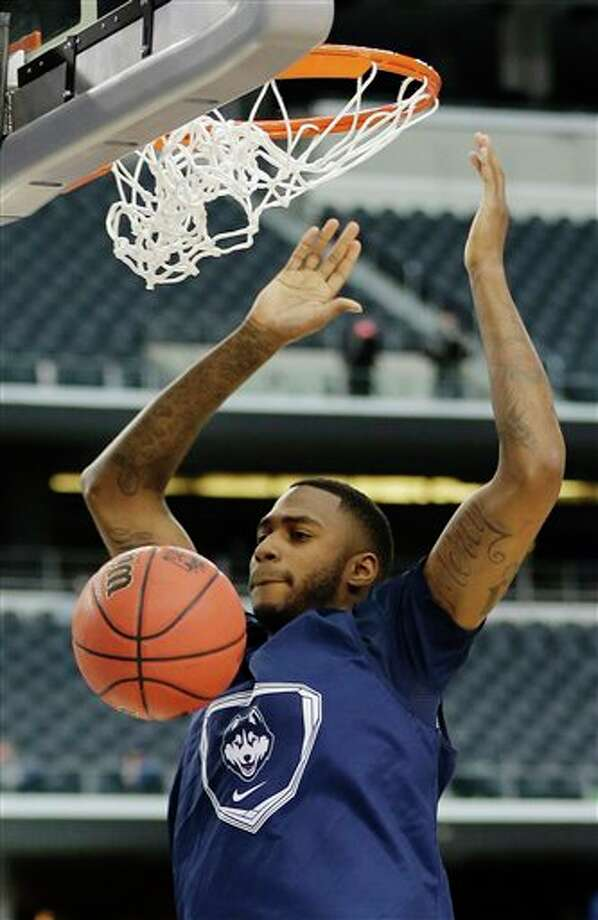 Connecticut forward Phillip  Nolan dunks the ball during practice for the team's NCAA Final Four  tournament college basketball semifinal game Friday, April 4, 2014, in  Dallas. Connecticut plays Florida on Saturday, April 5, 2014. (AP  Photo/Eric Gay)