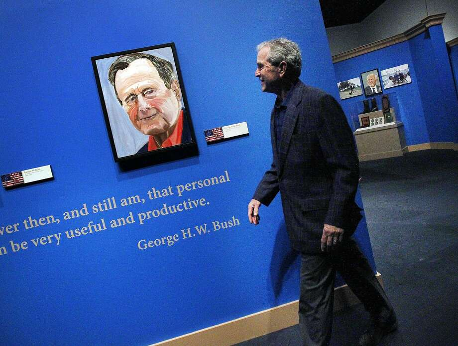 "Former President George W. Bush tours his new exhibition at his presidential library in Dallas. He readily acknowledges that ""the signature is worth more than the painting."" Photo: Mona Reeder, Associated Press"