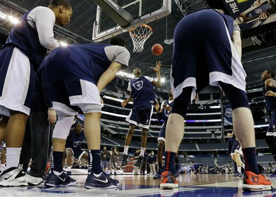 Connecticut players run a  drill during practice for their NCAA Final Four tournament college  basketball semifinal game Friday, April 4, 2014, in Dallas. Connecticut  plays Florida on Saturday, April 5, 2014. (AP Photo/David J. Phillip)