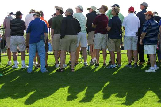 Golf fans watch a tee shot from the 18th hole during the round two of the Shell Houston Open at the Golf Club of Houston, Friday, April 4, 2014, in Humble. Photo: Marie D. De Jesus, Houston Chronicle / © 2014 Houston Chronicle