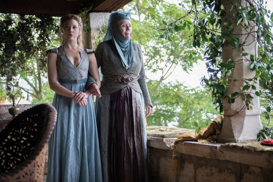 """Lady Margaery Tyrell (Natalie Dormer, left) and her grandmother, Olenna (Diana Rigg), prepare for Margaery's upcoming nuptials with King Joffrey in Season 4 of HBO's """"Game of Thrones."""" Photo: Macall B. Polay, HOEP / HBO"""