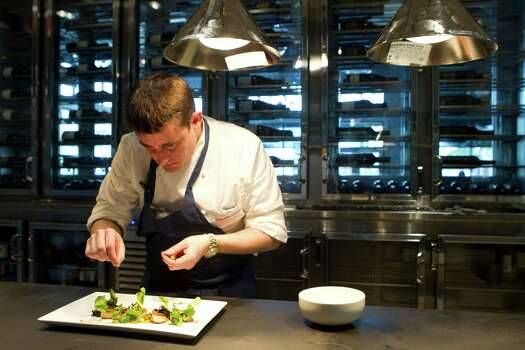 Executive chef Bryan Ogden prepares a dish in the kitchen at Bradley's Fine Diner, a new restaurant from James Beard Award-winning California chef Bradley Ogden, on Monday, March 31, 2014, in Houston. ( Brett Coomer / Houston Chronicle ) Photo: Brett Coomer, Staff / © 2014 Houston Chronicle