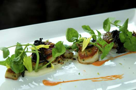 Seared Maine diver scallop, with Oregon morels, lemon gnocchi and wild watercress, is shown at Bradley's Fine Diner, a new restaurant from James Beard Award-winning California chef Bradley Ogden, on Monday, March 31, 2014, in Houston. ( Brett Coomer / Houston Chronicle ) Photo: Brett Coomer, Staff / © 2014 Houston Chronicle