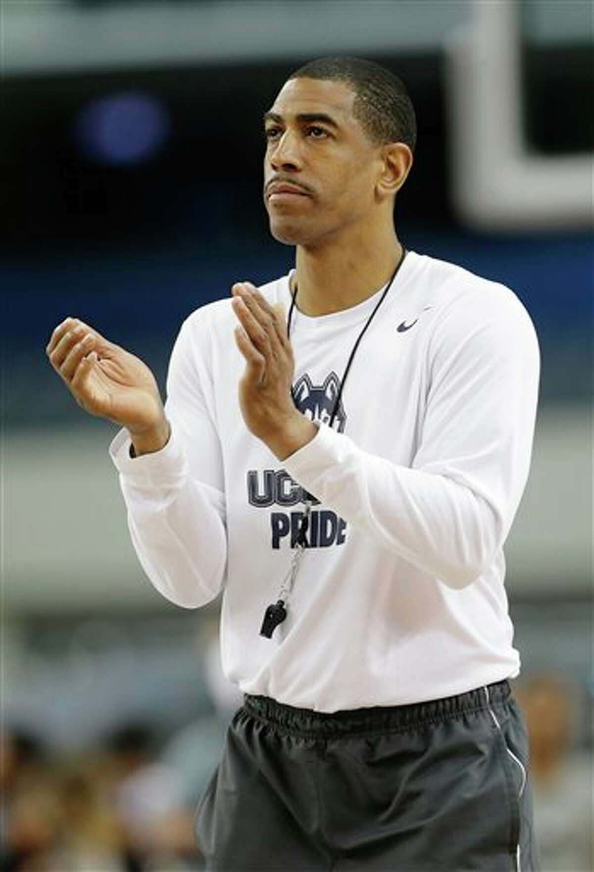 Connecticut head coach Kevin Ollie runs practice for the team's NCAA Final Four tournament college basketball semifinal game Friday, April 4, 2014, in Dallas. Connecticut plays Florida on Saturday, April 5, 2014. (AP Photo/Tony Gutierrez)