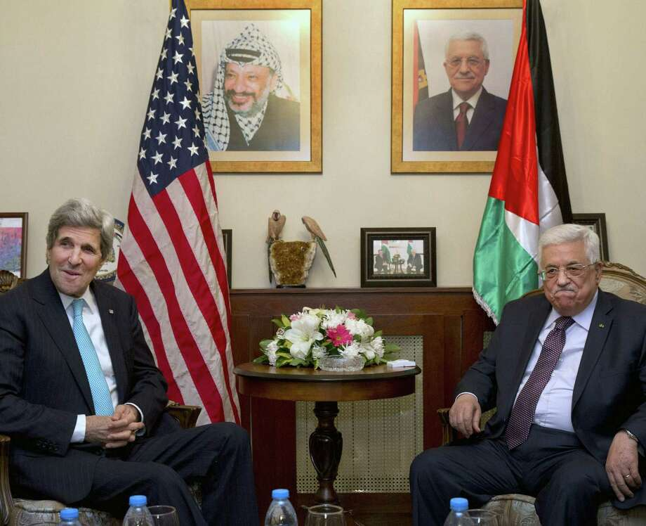 U.S. Secretary of State John Kerry (left) continues his fool's errand to keep Mahmoud Abbas at the negotiating table. Photo: AFP / Getty Images / AFP