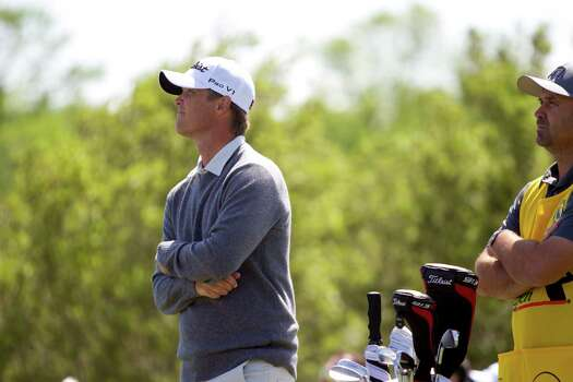 Matt Jones watches Paul Casey's tee shot from the 18th  hole on the round two of the Shell Houston Open at the Golf Club of Houston, Friday, April 4, 2014, in Humble. Photo: Marie D. De Jesus, Houston Chronicle / © 2014 Houston Chronicle