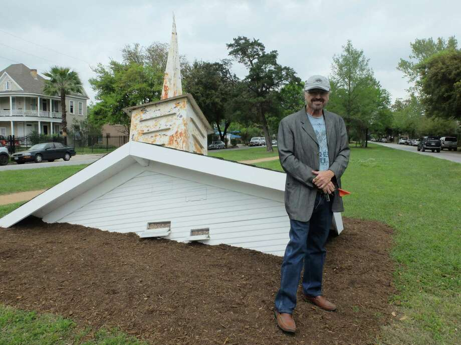 "Gus Kopriva, co-curator of the Heights Boulevard exhibit ""True North,"" is leading the effort to make art more accessible. One of the sculptures on view, Dan Havel's ""Bird Sanctuary,"" also functions as a feeder. Photo: Molly Glentzer / ONLINE_YES"
