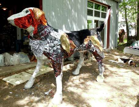 Carter Ernst's fiberglass sculpture of a dog stands guard outside her studio before making the trip to Heights Boulevard, where it will stay through Nov. 4.Keep clicking to see more of Houston's public art, past and present.  Photo: Lynet McDonald / ONLINE_YES