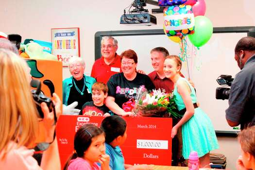 Pamela Berdou, center in glasses, poses with her family after being surprised in her classroom. Photo: Courtesy Lamar Consolidated Independent School District