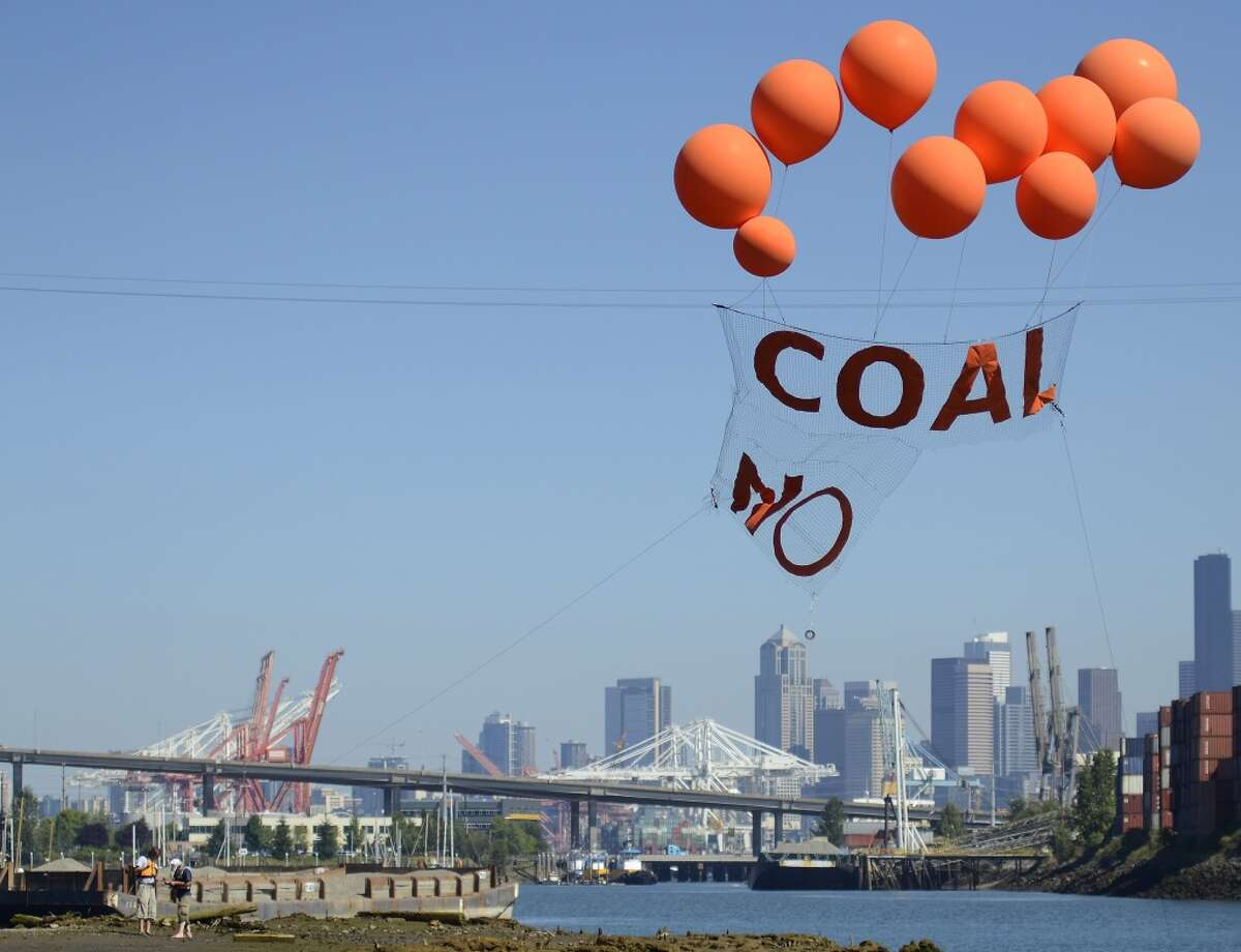 """A banner that reads """"Coal, No"""" flies over the Duwamish River Monday, Aug. 5, 2013."""
