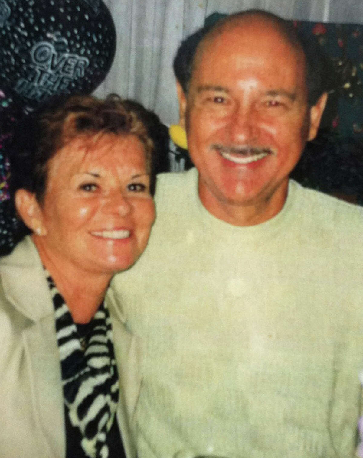 This photo made in 2000 and provided by Barbara Speranza via her attorney, shows Barbara Speranza, left, and her late husband Robert Speranza. Barbara Speranza is seeking damages against Stewart Leonard Sr., founder of Connecticut-based Stew Leonard's grocery store chain, and his son Thomas Leonard, for the death of Robert Speranza, who was swept off Leonard's boat and died in August 2011. A law suit was filed Wednesday March 7, 2012 in Bridgeport, Conn., Superior Court.
