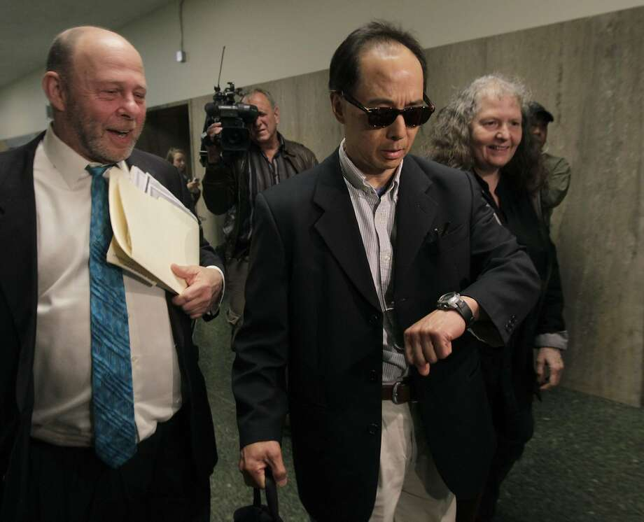 Former S.F. Supervisor Ed Jew (center) leaves the Hall of Justice with attorney Stuart Hanlon, who sought a credit for Jew's prison time on separate charges. Photo: Paul Chinn, The Chronicle