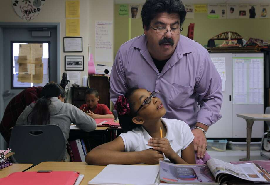 Teacher Louis Edney assists McKayla Cates with her creative writing assignment at Bayside-Martin Luther King Academy school in Marin City, Calif. on Wednesday, March 26, 2014. Photo: Paul Chinn, The Chronicle