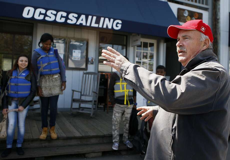 Skipper Anthony Sandberg (right) guides students from Oakland's Envision Academy charter high school at the Olympic Circle Sailing Club. Photo: Codi Mills, The Chronicle