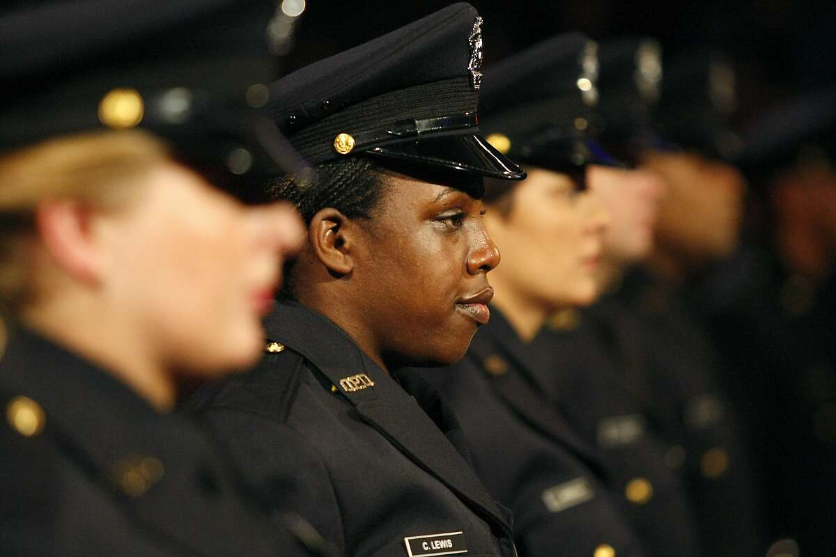 Courtney Lewis stands with other recruits during the 168th Oakland Police Recruit Academy graduation ceremony at the Scottish Rite Center in Oakland, CA, Friday April 3, 2014. The Oakland Police Department's 168th academy is the largest graduating class in OPD history with 47 graduates.