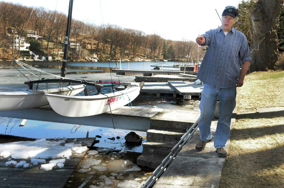 Tom Tunderman, who owns a home on Candlewood Lake in Danbury,  talks about the damage done by the lake's floating sheets of ice to homeowners' docks, Thursday, April 3, 2014. Photo: Carol Kaliff / The News-Times