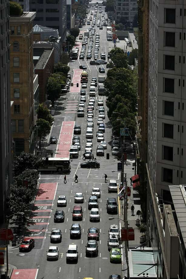 Traffic on Third Street downtown, typically among the busiest thoroughfares, is seen as backed up, but a study shows speeds are actually seconds faster. Photo: Michael Short, The Chronicle