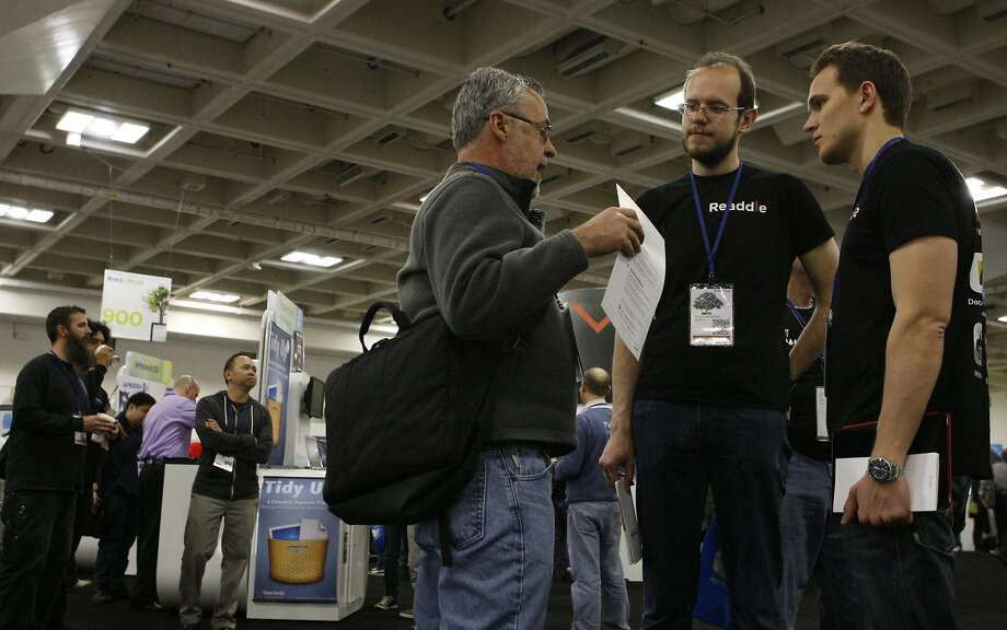 Mike Stearns (left) chats with Andrian Budantsov and Denys Zhadanov of Ukraine during Macworld last month in San Francisco. Photo: Codi Mills, The Chronicle