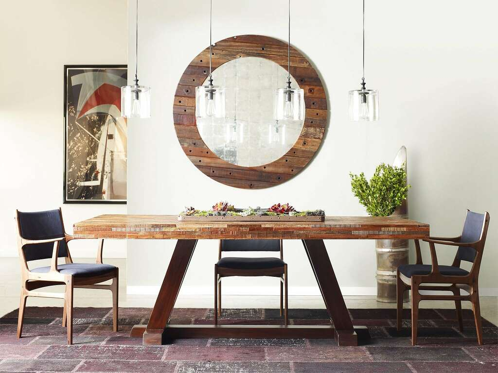 The Max dining table boasts a mixture of recycled hardwoods reclaimed from  old buildings. Photo