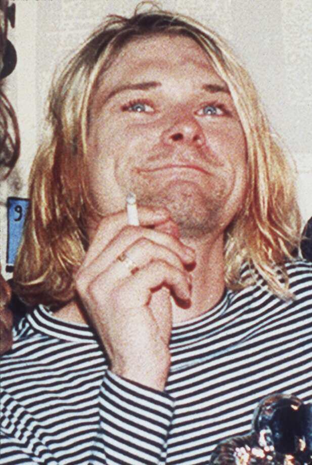 In this 1993 file photo, lead singer of Nirvana Kurt Cobain is photographed. Seattle police  in April 2014, plan to release new photographs discovered during a re-examination of the death of Nirvana's  Cobain. Cobain, who was 27 when he died.   (AP Photo/Mark J.Terrill, file) Photo: Mark Terrill, Associated Press