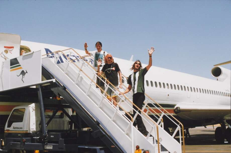Dave Grohl, Kurt Cobain, and Krist Novoselic boarding an airplane in Australia, circa February 10, 1992. Courtesy of Shelli Hyrkas. On display as part of the Experience Music Project. Photo: Courtesy Of Shelli Hyrkas