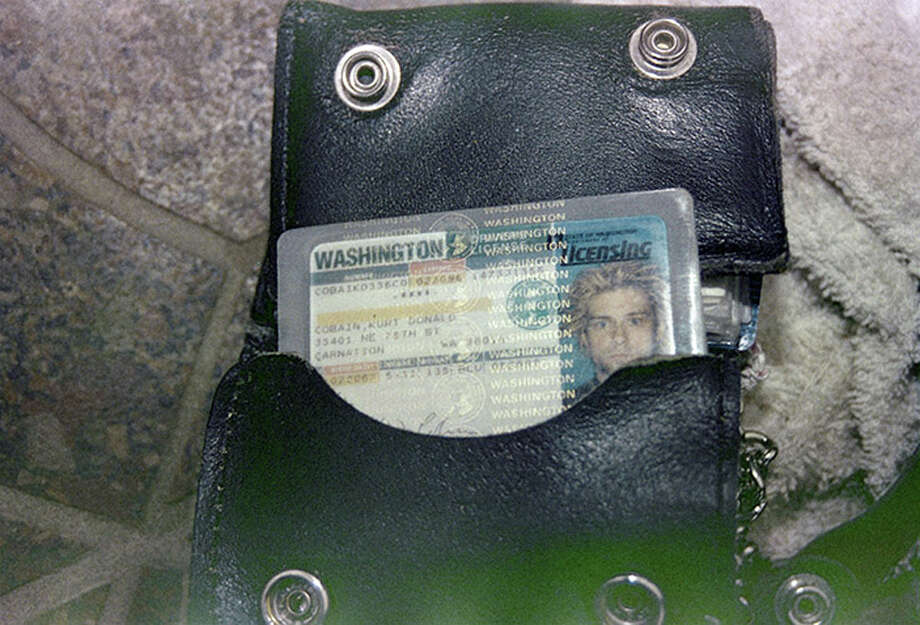This April 1994 photo provided by the Seattle Police Department shows a wallet containing Kurt Cobain's Washington state driver's license, found at the scene of his suicide, in Seattle. (AP Photo/Seattle Police Department) Photo: Uncredited, Associated Press / Seattle Police Department