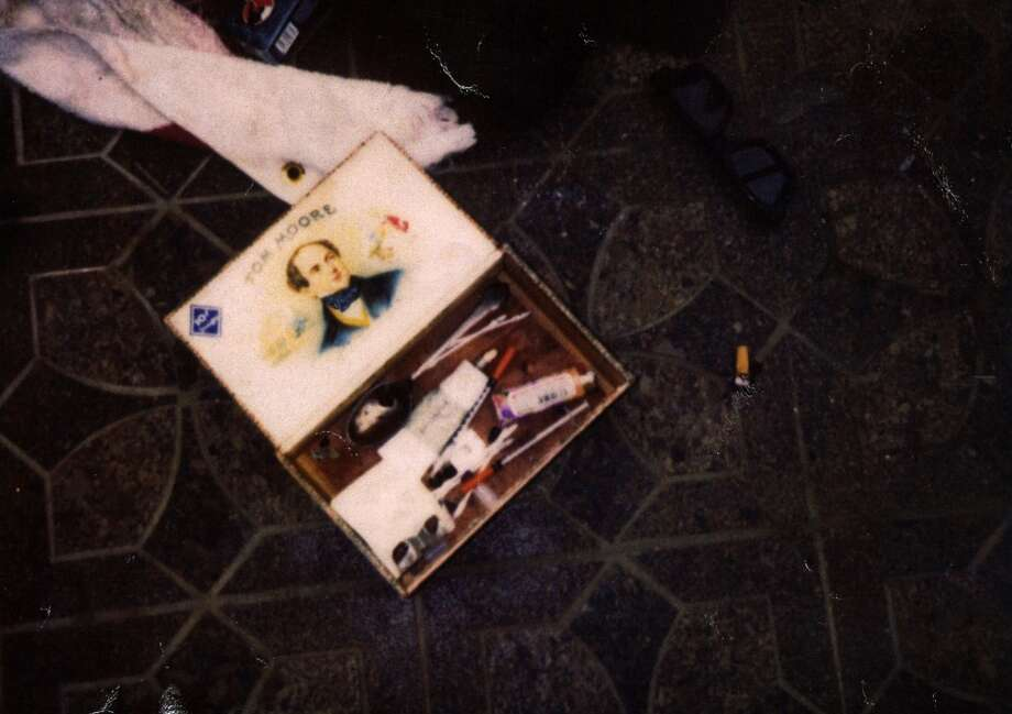 This April 1994 photo provided by the Seattle Police Department shows items found at the scene of Kurt Cobain's suicide, in Seattle. The image has never before been released. Police spokeswoman Renee Witt said Thursday, March 20, 2014, that several rolls of undeveloped film were found when a detective re-examined the Cobain case recently. (AP Photo/Seattle Police Department) Photo: Uncredited, Associated Press