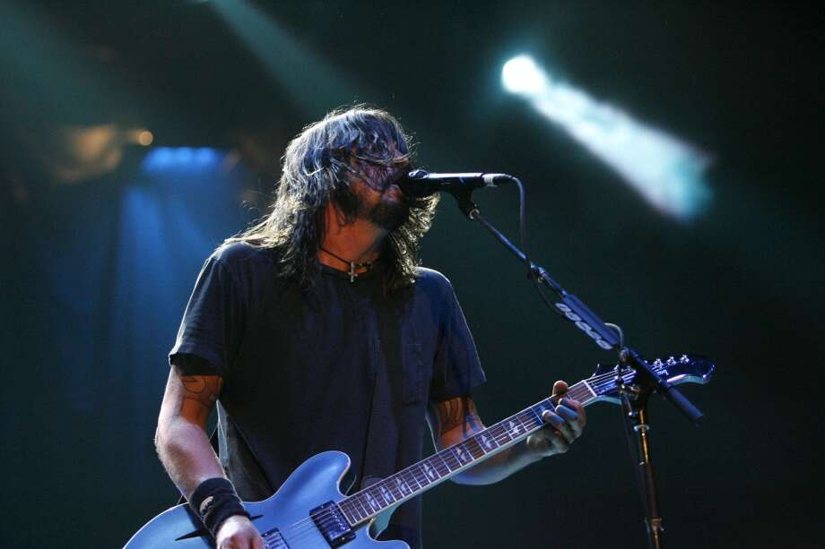 Foo Fighters guitarist and vocalist Dave Grohl performs at the Toyota Center Tuesday, Jan. 22, 2008, in Houston. ( Johnny Hanson / Chronicle) Photo: Johnny Hanson, Houston Chronicle