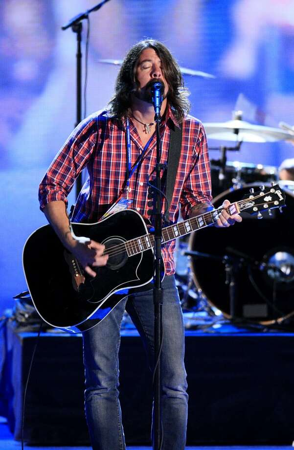 Dave Grohl of the Foo Fighters performs during a sound check on day three of the Democratic National Convention (DNC) in Charlotte, North Carolina, U.S., on Thursday, Sept. 6, 2012. President Barack Obama's prime-time nomination acceptance speech tonight at the 