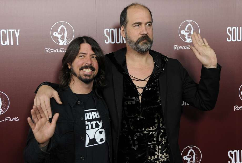 "In this Jan. 31, 2013 file photo, Dave Grohl, left, poses with Nirvana bandmate Krist Novoselic at the premiere of the documentary film ""Sound City,"" in Los Angeles. Nirvana will be inducted into the 2014 Rock and Roll Hall of Fame on April 10 at the Barclays Center in New York. (Photo by Chris Pizzello/Invision/AP, File) Photo: Chris Pizzello, Associated Press"