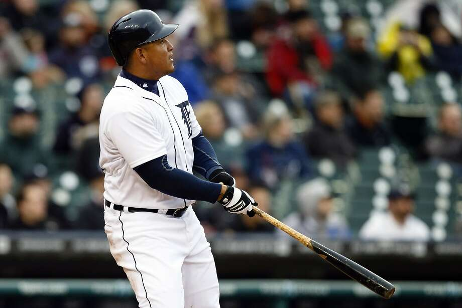 Detroit's Miguel Cabrera follows the flight of his eighth-inning home run, which was also career hit No. 2,000. Photo: Rick Osentoski, Reuters