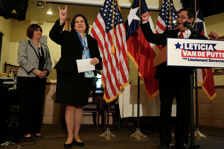 State Senator Leticia Van de Putte is introduced by Fort Worth City Councilman Sal Espino, right, during a meet and greet at Nuevo Leon restaurant in Fort Worth as she campaigns for Lt. Governor on Thursday, April 3, 2014. At left is Van de Putte's sister, Annabelle Garcia. Photo: Lisa Krantz, SAN ANTONIO EXPRESS-NEWS / SAN ANTONIO EXPRESS-NEWS