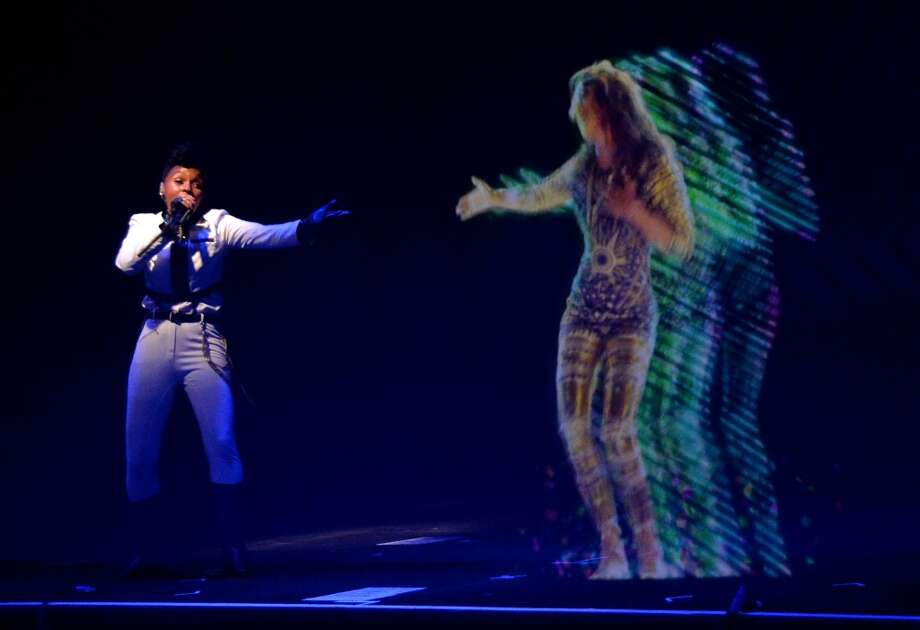 Singer Janelle Monae and a M.I.A. hologram perform during Audi A3 Launch Party with Janelle Monae at Quixote Studios on April 3, 2014 in Los Angeles, California. Photo: Michael Buckner, Getty Images For Audi