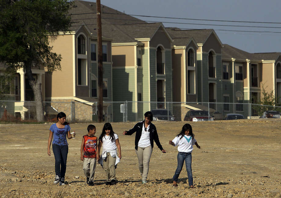 Minorities accounted for 89 percent of state growth in 2010. Is Texas making the kinds of investments needed? Kids living in District 2 on the city's East Side walk toward Woodard Community Center near Walters Street in 2011. Photo: Kin Man Hui / San Antonio Express-News / San Antonio Express-News