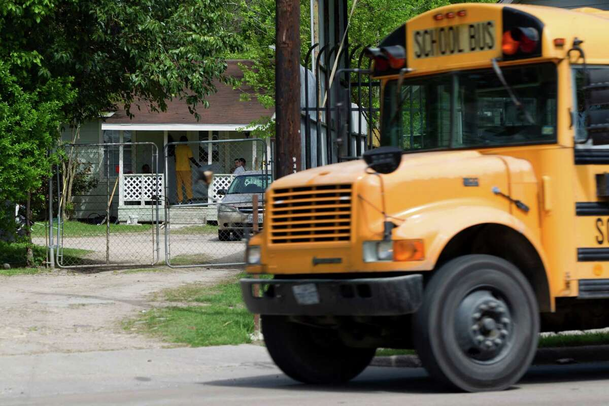 A school bus passes by a home where high-risk sex offenders had been moved to on the 9300 block of W. Montgomery Road in the Acres Homes neighborhood Friday, April 4, 2014, in Houston. The high-risk offenders had been moved out of the halfway house because they were taking up beds there that were needed for low-risk regular felons who were exiting prison on parole, for treatment and rehabilitation programs.