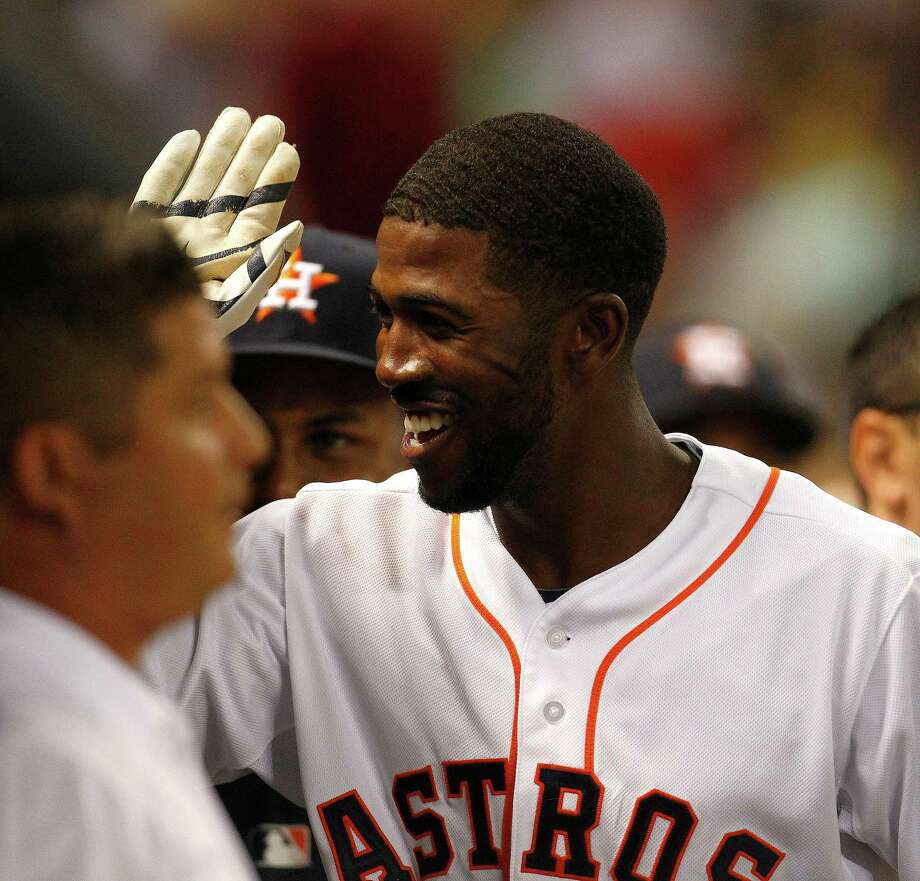 Houston Astros center fielder Dexter Fowler is congratulated by teammates in the dugout after his home run during the first inning of an MLB baseball game at Minute Maid Park, Wednesday, April 2, 2014, in Houston. ( Karen Warren / Houston Chronicle  ) Photo: Karen Warren, Staff / © 2014 Houston Chronicle