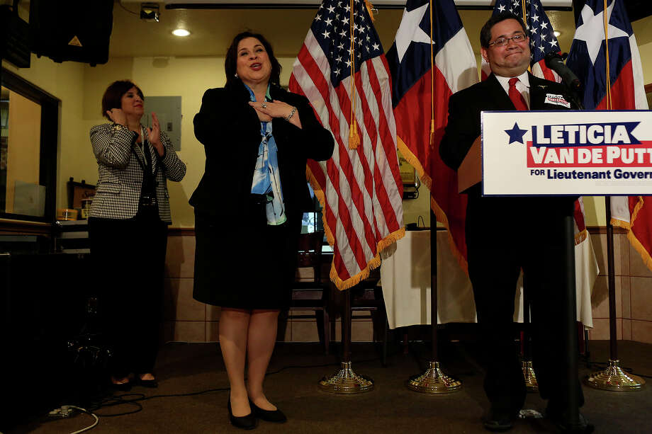 State Senator Leticia Van de Putte reacts to a round of applause from the crowd gathered for a meet and greet as she is introduced by Fort Worth City Councilman Sal Espino, right, at Nuevo Leon restaurant in Fort Worth as she campaigns for Lt. Governor on Thursday, April 3, 2014. At left is Van de Putte's sister, Annabelle Garcia. Photo: Lisa Krantz, SAN ANTONIO EXPRESS-NEWS / SAN ANTONIO EXPRESS-NEWS