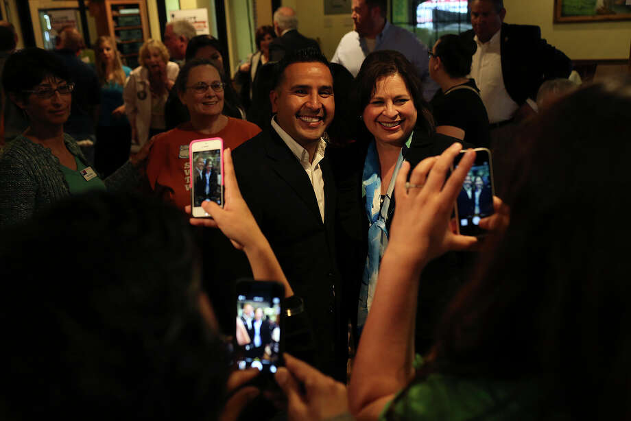 State Senator Leticia Van de Putte is photographed with community organizer Macario Belmontes during a meet and greet at Nuevo Leon restaurant in Fort Worth as she campaigns for Lt. Governor on Thursday, April 3, 2014. Photo: Lisa Krantz, SAN ANTONIO EXPRESS-NEWS / SAN ANTONIO EXPRESS-NEWS
