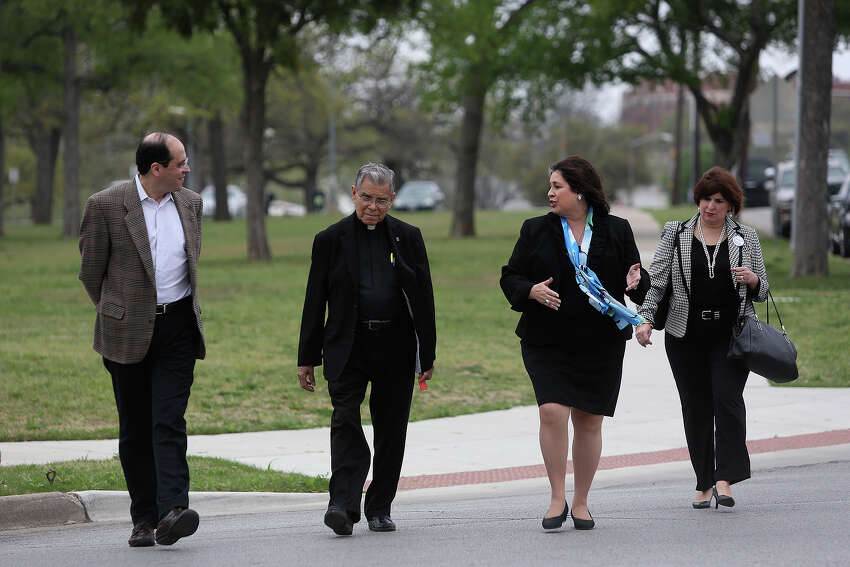 State Senator Leticia Van de Putte walks to a meet and greet with Father Stephen Jasso, center, and her sister, Annabelle Garica, right, as she campaigns for Lt. Governor in Fort Worth on Thursday, April 3, 2014. Van de Putte lit a candle at Father Jasso's church, All Saints Catholic Church, for the victims of the Ft. Hood shooting.