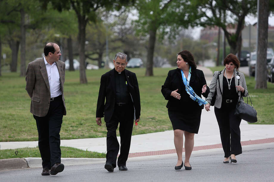 State Senator Leticia Van de Putte walks to a meet and greet with Father Stephen Jasso, center, and her sister, Annabelle Garica, right, as she campaigns for Lt. Governor in Fort Worth on Thursday, April 3, 2014. Van de Putte lit a candle at Father Jasso's church, All Saints Catholic Church, for the victims of the Ft. Hood shooting. Photo: Lisa Krantz, SAN ANTONIO EXPRESS-NEWS / SAN ANTONIO EXPRESS-NEWS